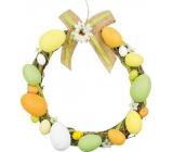 Wicker wreath with plastic eggs 25 cm